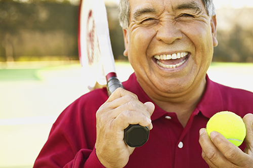 Marysville, WA man smiling about his successful root canal procedure by his dentist.